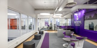 New modern offices and contemporary classroom space juxtaposed with a historical building and location in downtown Rochester, Minnesota create a vibrant atmosphere for a forward-thinking university. Winona State University - Rochester desired a downtown location to strengthen its position as a viable pathway to healthcare careers.  Not all historic renovations are classified as preservation projects. On the third floor of the Historic Riverside building, the WSU - Rochester project renovated and modernized a space that had been renovated many times throughout the years.  Due to the many renovations, very few original elements of the building remained.  Modern fixtures and lively splashes of color provided a desirable indoor environment within the history-rich building.
