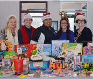 Employees behind donated gifts for Adopt a Family Tree