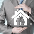 Figurative image of insurance agent holding house with family icon cut out
