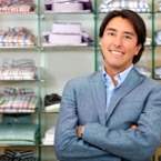 Retail environment showing owner in a clothing store