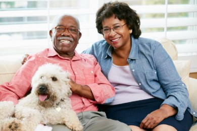 Elderly couple with dog.
